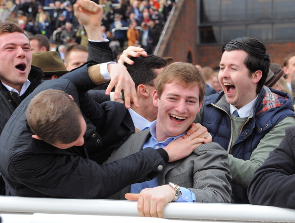 Racegoers celebrate after the William Hi